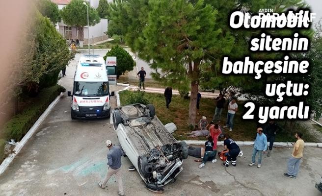 Otomobil sitenin bahçesine uçtu: 2 yaralı