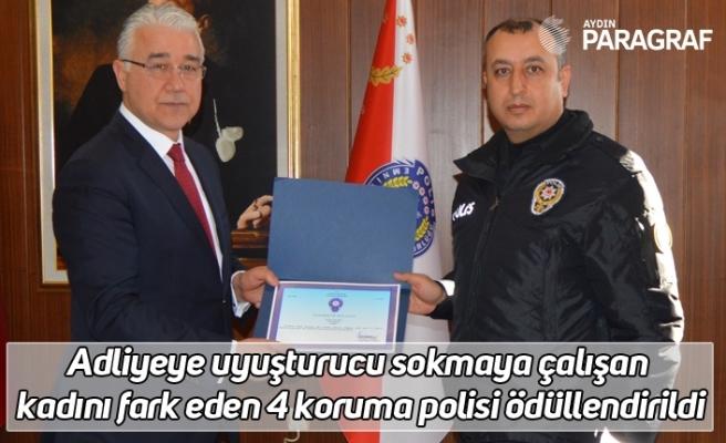 Adliyeye uyuşturucu sokmaya çalışan kadını fark eden 4 koruma polisi ödüllendirildi