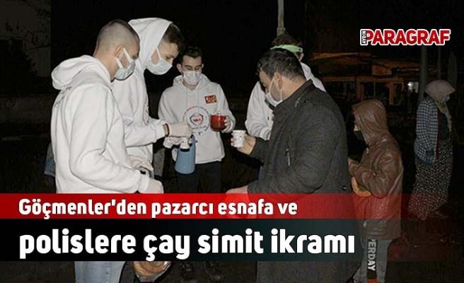 Göçmenler'den pazarcı esnafa ve polislere çay simit ikramı