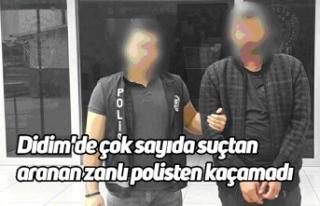 Didim'de çok sayıda suçtan aranan zanlı polisten...